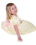 Girl in cream party dress Stock Images