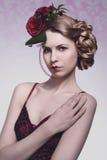 Girl with creative floral hair-style Stock Photos