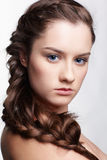 Girl with creative hair-do. Hairstyle portrait of beautiful brunette girl with creative braid hairdo Stock Image