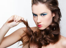 Girl with creative hair-do. Hairstyle portrait of beautiful brunette girl with creative braid hairdo Stock Photography
