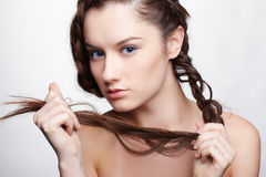 Girl with creative hair-do Stock Photography