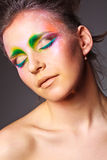 Girl with a creative make-up on face Stock Photo