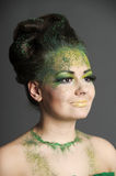 Girl with creative make-up green Stock Photography