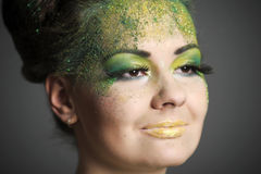 Girl with creative make-up green Royalty Free Stock Images