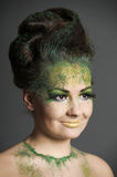 Girl with creative make-up green Royalty Free Stock Photo