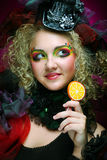Girl with  with creative make-up holds  lollipop Royalty Free Stock Image