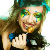 Girl with  with creative make-up holds  lollipop Stock Images