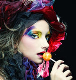 Girl with  with creative make-up holds  lollipop Royalty Free Stock Photo