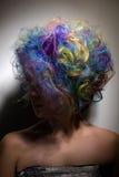 Girl with creative make up, very long false eyelashes and professional hair colouring Royalty Free Stock Photo