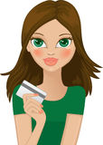 Girl with credit card Royalty Free Stock Photography