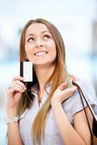 Girl with a credit card Royalty Free Stock Image