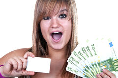 Girl with credit card and bills. On white background Stock Photography