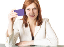 Girl with credit card in hand Royalty Free Stock Photos