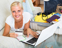 Girl with credit card and laptop Royalty Free Stock Photo