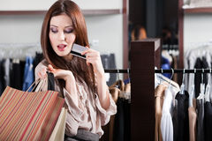 Girl with credit card is in the shop Royalty Free Stock Photo