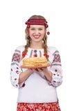 Girl with crepes celebrates Shrovetide Royalty Free Stock Photo