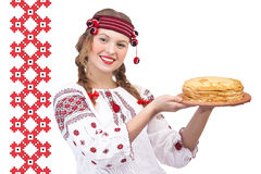 Girl with crepes on a national pattern Stock Photos