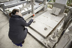 Girl cries burial. Sad girl in cemetery grave, religion Royalty Free Stock Photography