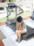 Girl cries at a sports training apparatus Royalty Free Stock Photo