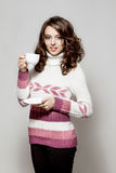 Girl in a crocheted clothes with cup of coffee Stock Photo