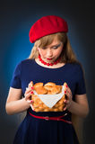 Girl and croissant. Beautiful girl with a few croissants Royalty Free Stock Image