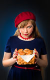 Girl and croissant. Beautiful girl with a few croissants Royalty Free Stock Images