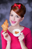 Girl with croissant and cup Stock Photos