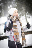 A girl cross-country skiing in a snowy forest Royalty Free Stock Images