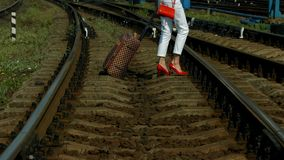 Girl cross the rails. stock video footage