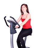 Girl cross trainer exercise Royalty Free Stock Images