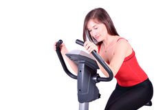 Girl on cross trainer fitness Royalty Free Stock Photography