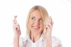 Girl with crossed fingers. Young woman showing crossing fingers gesture on isolated background Royalty Free Stock Image