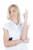Girl with crossed fingers. Young woman showing crossing fingers gesture on isolated background Stock Image
