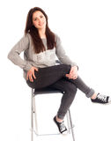 Girl with crossed legs on chair isolated Royalty Free Stock Photos