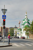 Girl crosses Street against Church of the Saviour Royalty Free Stock Photo