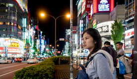 A girl is crossing Shinjuku shopping street. Tokyo, Japan - May 5, 2017: A girl is crossing Shinjuku shopping street Stock Photo