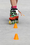 Girl crossing while skating. With cones Royalty Free Stock Image