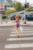 Girl Crossing the Street. Young sexy girl crossing the street in the town of Kavala, Greece Royalty Free Stock Photo