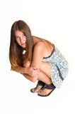 Girl crouch on the floor. Stock Image