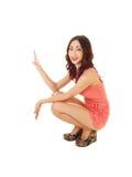 Girl crouching on floor. Royalty Free Stock Photos