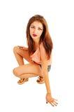 Girl crouching on floor. Stock Photos