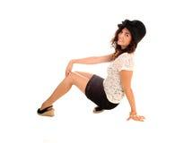 Girl crouching on floor. Stock Image