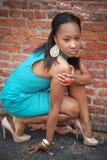 Girl crouching two Stock Image