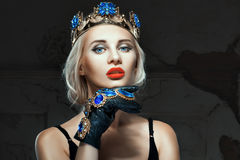 Girl with a crown on his head and blue eyes. Royalty Free Stock Photography
