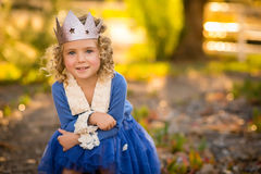 Girl child in Crown. Young girl with curly hair in purple dress and crown Stock Image