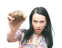 The girl with a crude potato in hands Royalty Free Stock Photos