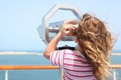 Girl on cruise liner deck and looking in binocuarl Stock Photography