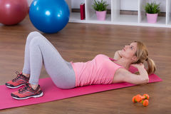 Girl and crunches Royalty Free Stock Images