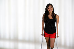 Girl On Crutches Stock Photography