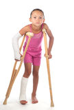 Girl with crutches Stock Photography